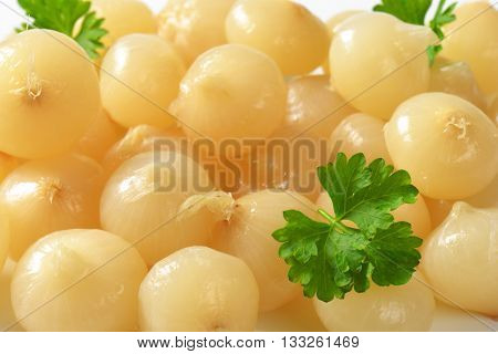 close up of small pickled onions with parsley