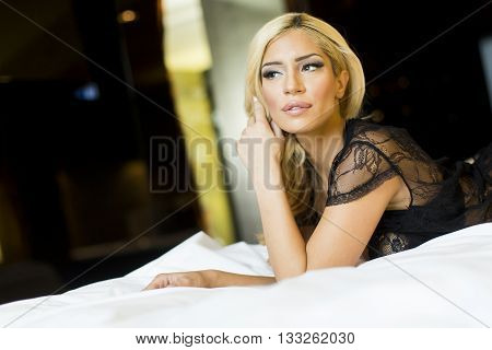 Pretty Young Woman Laying On The Bed