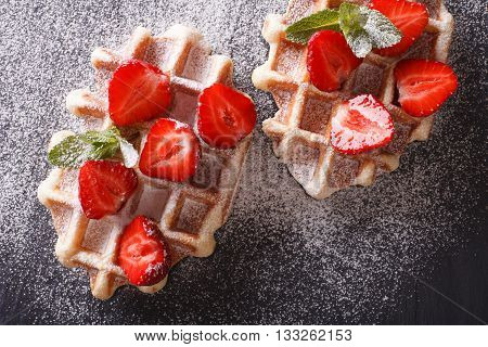 Tasty Waffles With Fresh Strawberries, Powdered Sugar Close-up On The Slate. Horizontal Top View