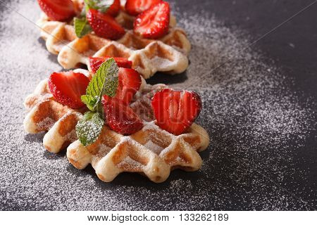 Tasty Dessert: Waffles With Fresh Strawberries, Powdered Sugar On The Slate. Horizontal