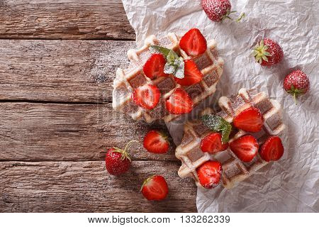Belgian Waffles With Strawberries And Powdered Sugar Closeup. Horizontal Top View