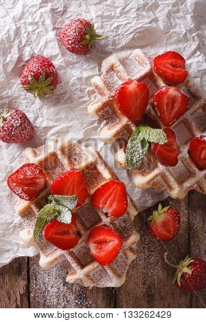 Rustic Waffles With Strawberries, Powdered Sugar And Mint Closeup. Vertical Top View