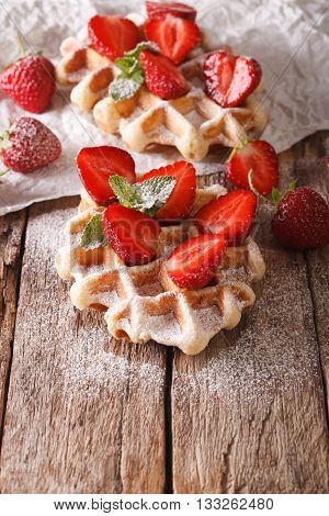Rustic Waffles With Strawberries, Powdered Sugar And Mint Closeup. Vertical