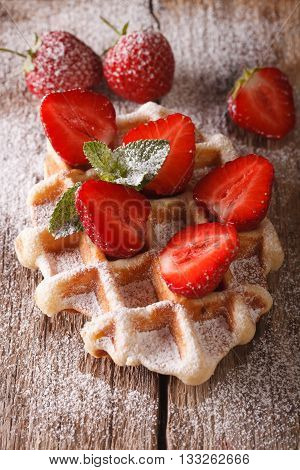 Belgian Waffles With Strawberries And Powdered Sugar Close-up. Vertical