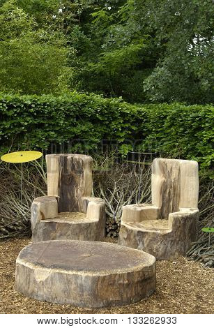 table and chairs in a modern garden in France