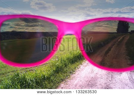 On a dirt road with my pink sunglasses
