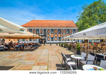 Varazdin, Croatia - May 27th, 2016, Beautiful Sermage palace in the center of old baroque town of Varazdin, Croatia, cafes on public square. Popular tourist place