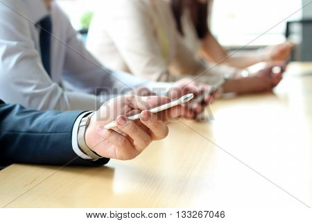 Close up of a business people using mobile smart phones