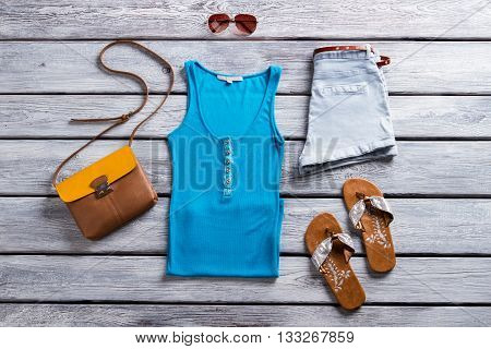 Blue tank top and shorts. Footwear and buttoned tank top. New items from summer catalog. Time to dress up.