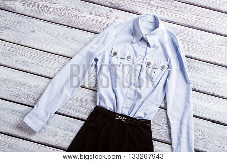 Light blue shirt with pockets. Casual long sleeve shirt. Light top and dark bottom. Clothes from top rated seller.