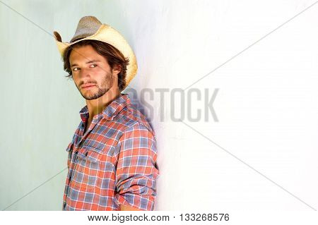 Young Man Looking Serious In Cowboy Hat