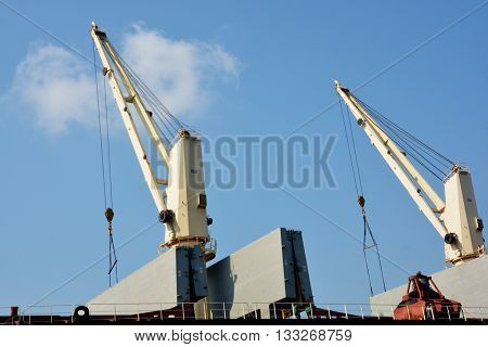 Cranes on the ship, harbor cranes loaded containers on the ship