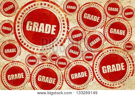 grade, red stamp on a grunge paper texture