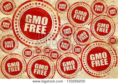 gmo free, red stamp on a grunge paper texture