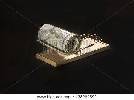 Wad of dash dollars on a mouse Trap