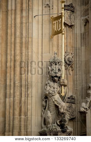 London United Kingdom - June 5th 2016: Statue of a lion on the Palace of Westminster at the Sovereign's entrance under the Victoria Tower.