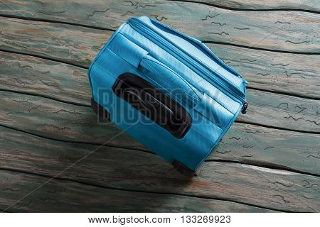 Blue luggage bag with handle. Top view of a suitcase. Things are packed. Few hours before departure.
