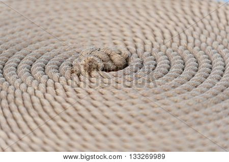 Coiled rope from tall ship rigging arranged in a circle