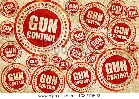 gun control, red stamp on a grunge paper texture