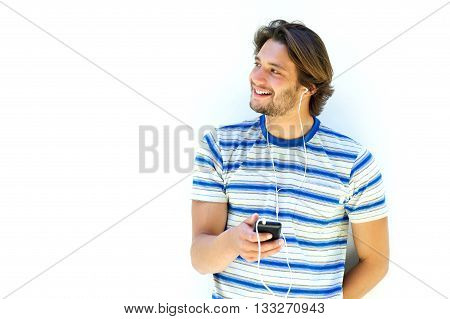 Attractive Young Man Smiling And Holding Mp3 Player