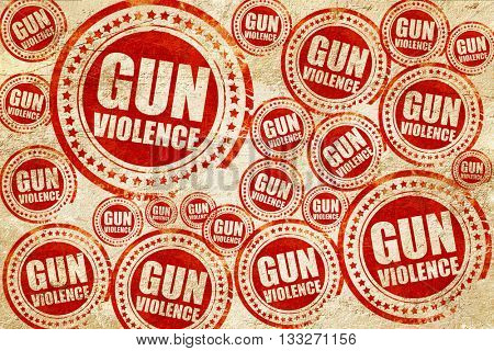 gun violence, red stamp on a grunge paper texture