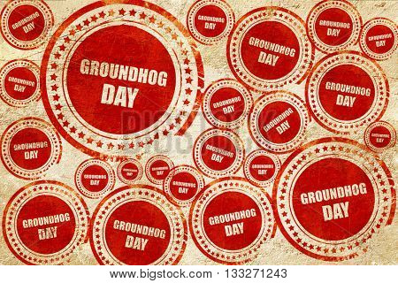 groundhog day, red stamp on a grunge paper texture