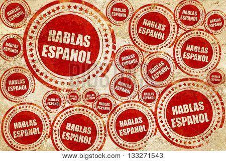 hablas espanol, red stamp on a grunge paper texture