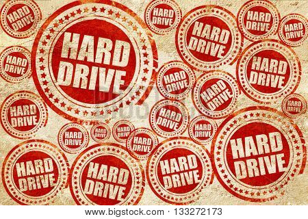 harddrive, red stamp on a grunge paper texture