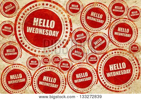 hello wednesday, red stamp on a grunge paper texture