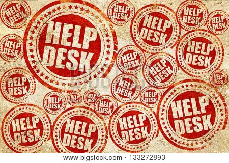 Helpdesk, red stamp on a grunge paper texture