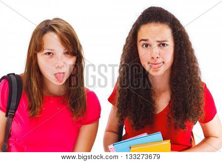 Teenage college friends sticking their tongue out. Isolated