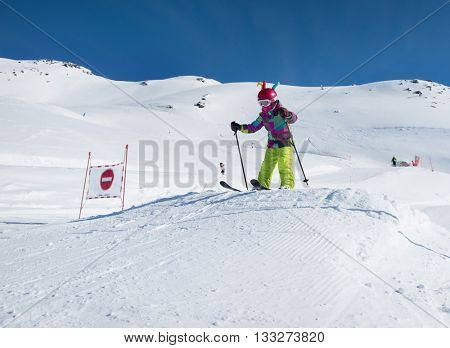 Young skier riding in the snowy mountains