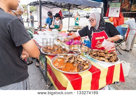 KUALA LUMPUR MALAYSIA June 7 2016: First day of Ramadan with food vendors at street bazaar selling delicacies catered for iftar or buka puasa.