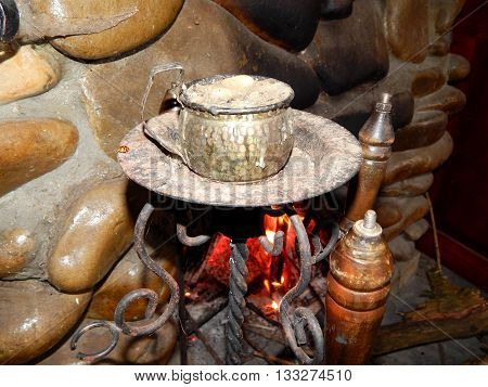 Wood burning stove with metal cutlery barbecue