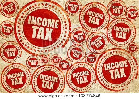 income tax, red stamp on a grunge paper texture