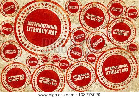international literacy day, red stamp on a grunge paper texture