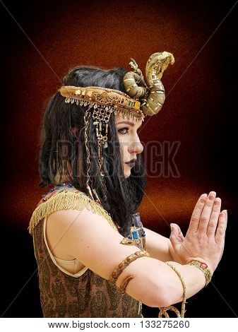 young girl dressed in Cleopatra costume, pose, studio shot