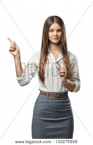Businesswoman stands pointing somewhere. Cut-out photo. Learning and cognition. Success and development. Business staff. Office clothes. Dress code. Presentable appearance. Sign and symbol.