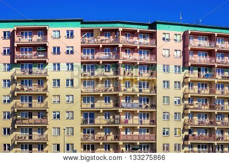 Dense high -rise residential building. Many apartaments.