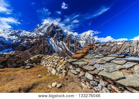 Beautiful alpine scenery in the Himalayas, with snow capped mountains and moraine glacier valley