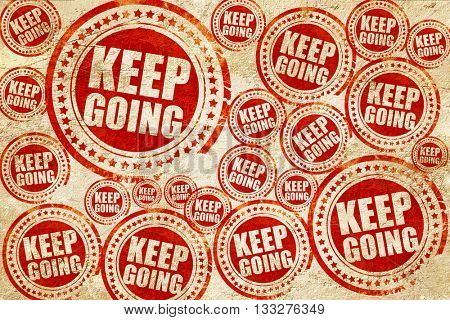 keep going, red stamp on a grunge paper texture