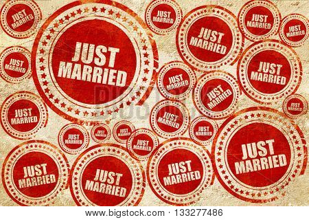 just married, red stamp on a grunge paper texture