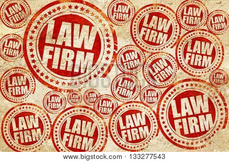 law firm, red stamp on a grunge paper texture
