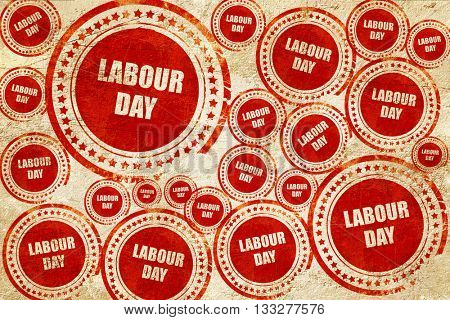 labour day, red stamp on a grunge paper texture