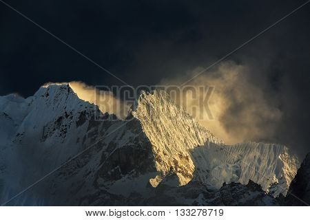 Dramatic sea of clouds and snow covered peaks in Himalaya