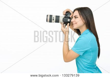 Smiling Woman in blue polo taking some shoots on camera