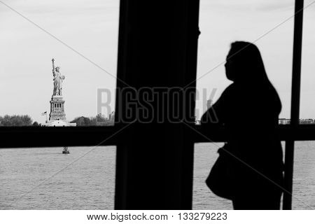 Woman Looking At The Statue Of Liberty