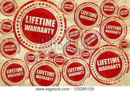 lifetime warranty, red stamp on a grunge paper texture