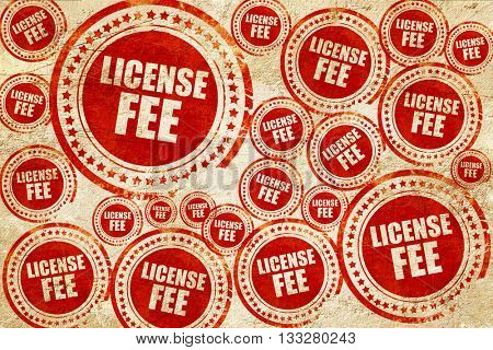 license fee, red stamp on a grunge paper texture