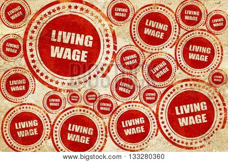 living wage, red stamp on a grunge paper texture